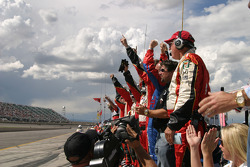 Andretti Green Racing crew members celebrate victory
