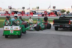 Team 7-11 roll Tony Kanaan's car out onto the grid