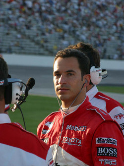 Helio Castroneves watches the big screen during qualifying