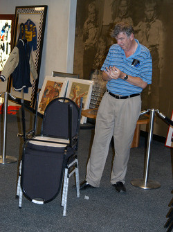 Even IMS historian Donald Davidson gets in on the act of unwrapping chairs
