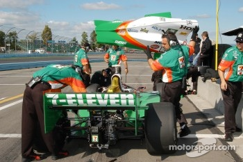 Tony Kanaan having his car adjusted