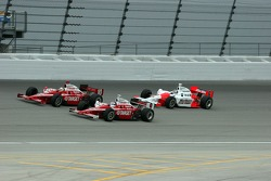 Dan Wheldon, Scott Dixon and Sam Hornish Jr. race for the lead