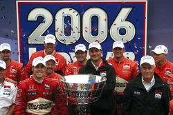 2006 IndyCar series champion Sam Hornish Jr., Tim Cedric and Roger Penske celebrate