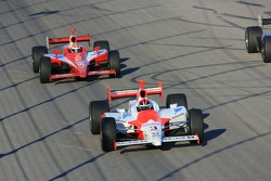 Helio Castroneves leads Dan Wheldon
