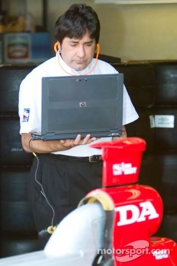 Honda technician monitors engine via laptop