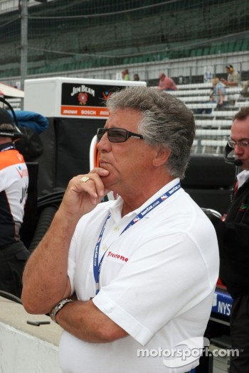 Mario Andretti watches Michael practice on the big screen