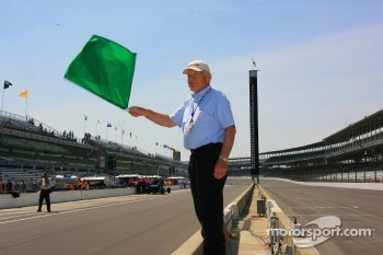 Bill Spoerle, chief restauration manager at the IMS Hall of Fame Museum, waves the green flag