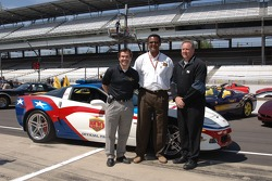 Guests pose in front of the 2006 Chevrolet Corvette Z06 Pace Car