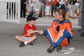 Sarah Fisher with a young fan