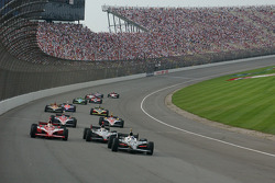 Dario Franchitti leads a group of cars