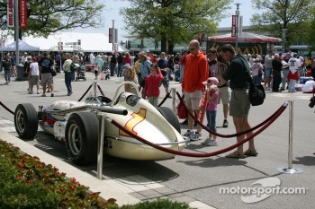 Fans looking at A.J. Foyt's 1964 winning car on display