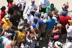 Tony Kanaan and Tomas Scheckter sign autographs