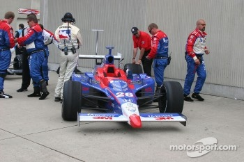 Marco Andretti's car sits in the garage area during the rain delay