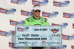 Scott Sharp receives a $10,000 check from AAMCO for winning the pole
