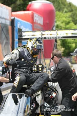 Tony Shumacher climbing out of his US Army Top Fuel Dragster