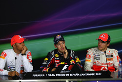 Lewis Hamilton, McLaren Mercedes with Sebastian Vettel, Red Bull Racing and Jenson Button, McLaren Mercedes