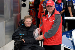Victory lane: winning team owner Sam Schmidt