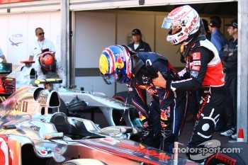 Jenson Button, McLaren Mercedes pulls Mark Webber, Red Bull Racing away from the car