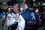 Provisional pole winner Stphane Sarrazin celebrates with Franck Montagny