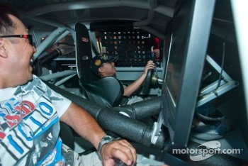 A young fan enjoys a NASCAR s-mulator