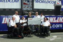 Sam Schmidt giving a check on behalf of his fundation