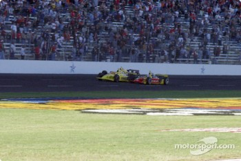 Sam Hornish Jr., Scott Sharp and Robbie Buhl at the checkered flag