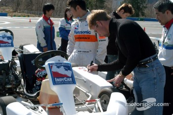 Greg Ray autographs a kart