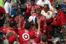 Scott Dixon- celebrates with the team after winning