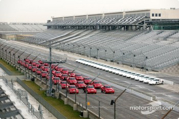 A fleet of Chevrolet SSR vehicles lined up on the front straightaway at Indianapolis