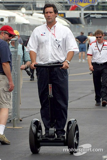 Tony George getting around on a segway