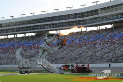 Safety crews inspect the damage that Robosaurs made to Bruton Smith's Cadillac
