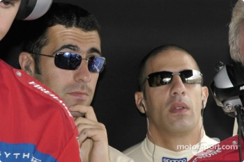 Dario Franchitti and Tony Kanaan watch the monitors