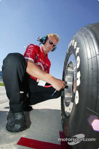 Crew member checks tire pressure