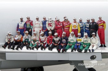 All of the CART drivers pose for a class photo on the wing of the FedEx plane