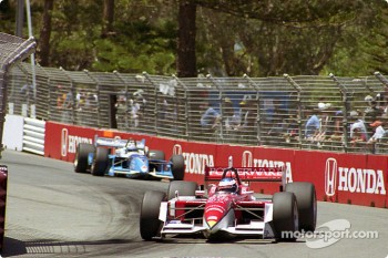 Scott Dixon in front of Patrick Carpentier