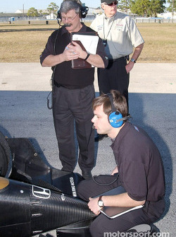 Martin Paré debriefs with Nakano while Don Halliday looks on