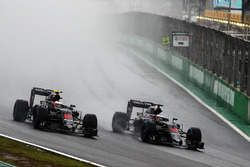 (L to R): Jenson Button, McLaren MP4-31 and team mate Fernando Alonso, McLaren MP4-31 battle for position