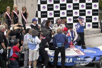 Victory circle: race winner Michael Andretti