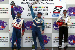 The podium: race winner Patrick Carpentier with Michael Andretti and Christian Fittipaldi