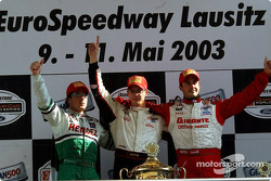 The podium: race winner Sébastien Bourdais with Mario Dominguez and Michel Jourdain Jr.