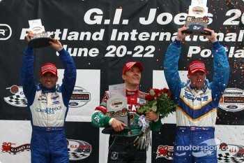 Podium: race winner Adrian Fernandez with Paul Tracy and Alex Tagliani
