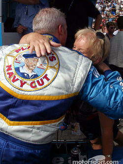 Paul Tracy hugs his mom after setting the fastest lap of the day