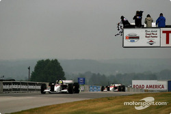 Bruno Junqueira takes the checkered flag ahead of Sébastien Bourdais