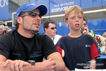 Alex Tagliani and young race fan representing the Muscular Dystrophy Association
