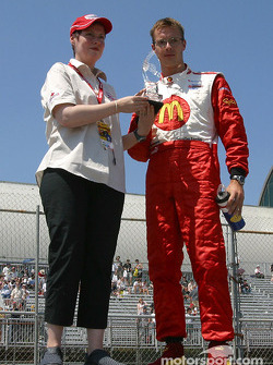 Sébastien Bourdais with the pole trophy