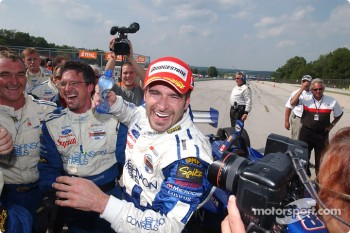 Race winner Alex Tagliani celebrates with his team