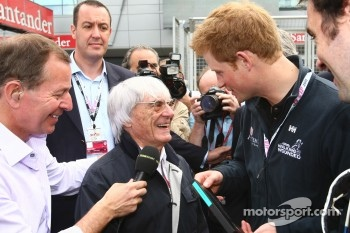 Bernie Ecclestone hands Prince Harry a F1 pass