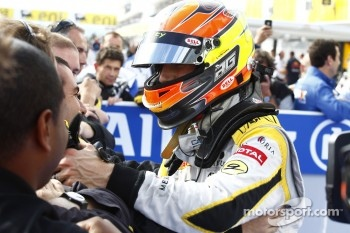 Romain Grosjean celebrates his victory