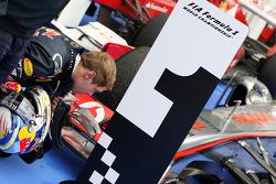 Sebastian Vettel, Red Bull Racing has a close look at the Mclaren in parc ferme