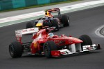 Fernando Alonso, Scuderia Ferrari leads Mark Webber, Red Bull Racing